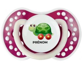 Jouet toys tortue avec roues avec prénom : Fuchsia phosphorescente Tétine embout Lovi Dynamic