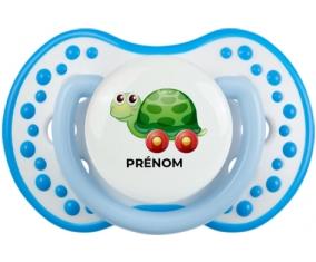 Jouet toys tortue avec roues avec prénom : Blanc-bleu phosphorescente Tétine embout Lovi Dynamic